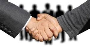 Two Men in Suits Shaking Hands - Working with a Local SEO Agency should be a partnership built on trust.
