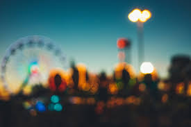 Blurry Photo of Fair with Farris Wheel - Metaphor for unclear or poorly understood SEO planning and reporting from your Local Agency